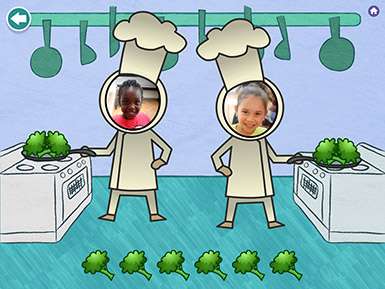 A screenshot from the Early Math with Gracie & Friends Photo Friends app shows the photos of two preschool girls as the faces of chef characters in the app who are seen cooking broccoli at stoves.